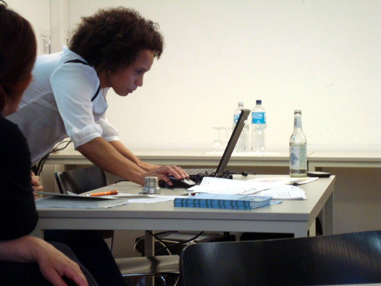 woman in front of laptop; leading the session